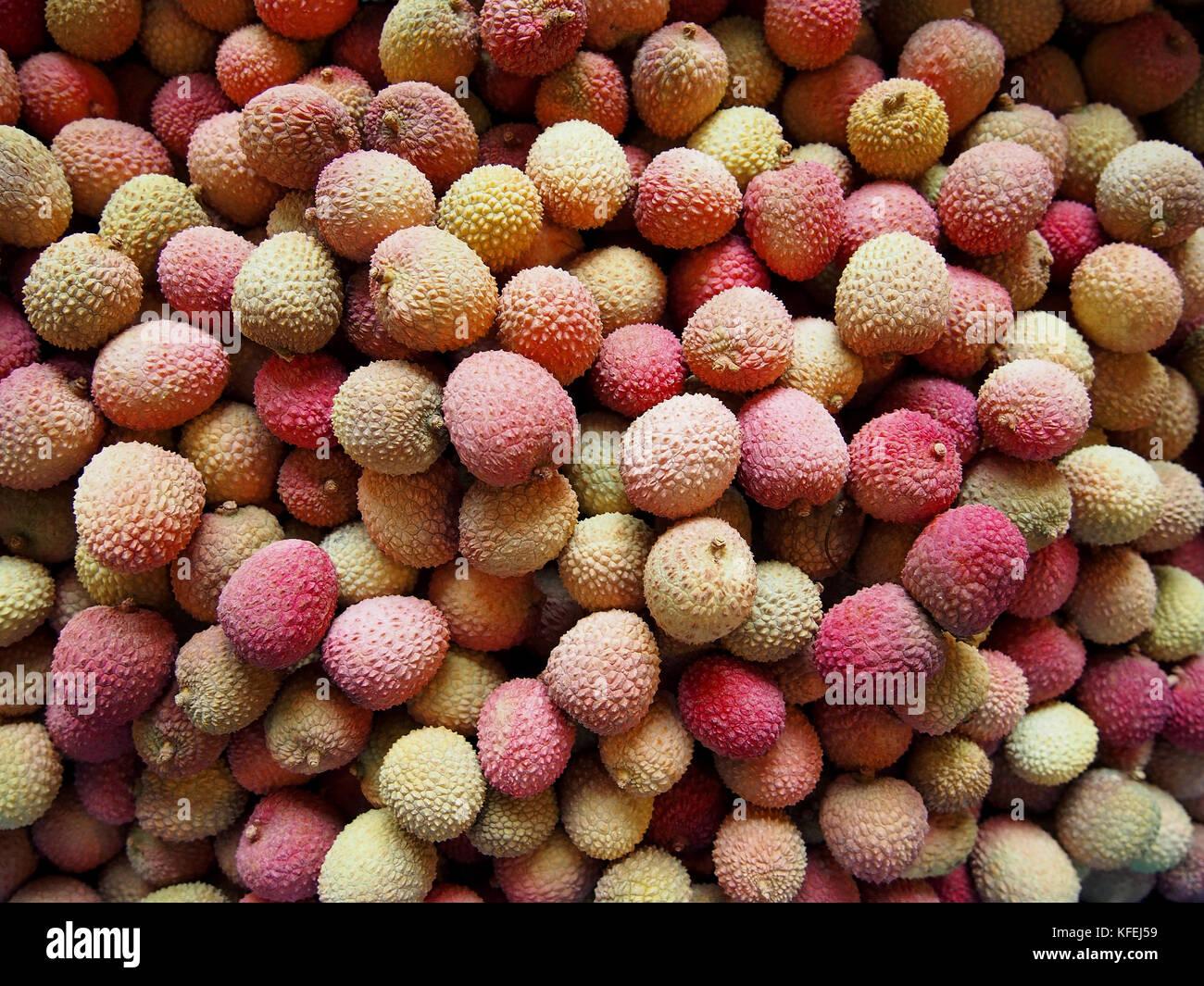 Litchi chinensis fruit close up shot in basket - Stock Image
