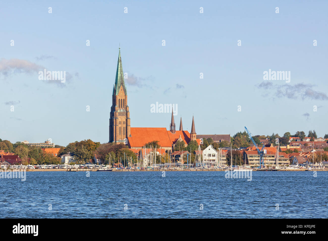Saint Peters church, known as Schleswig Cathedral, and the harbor of Schleswig on the Schlei inlet - Stock Image