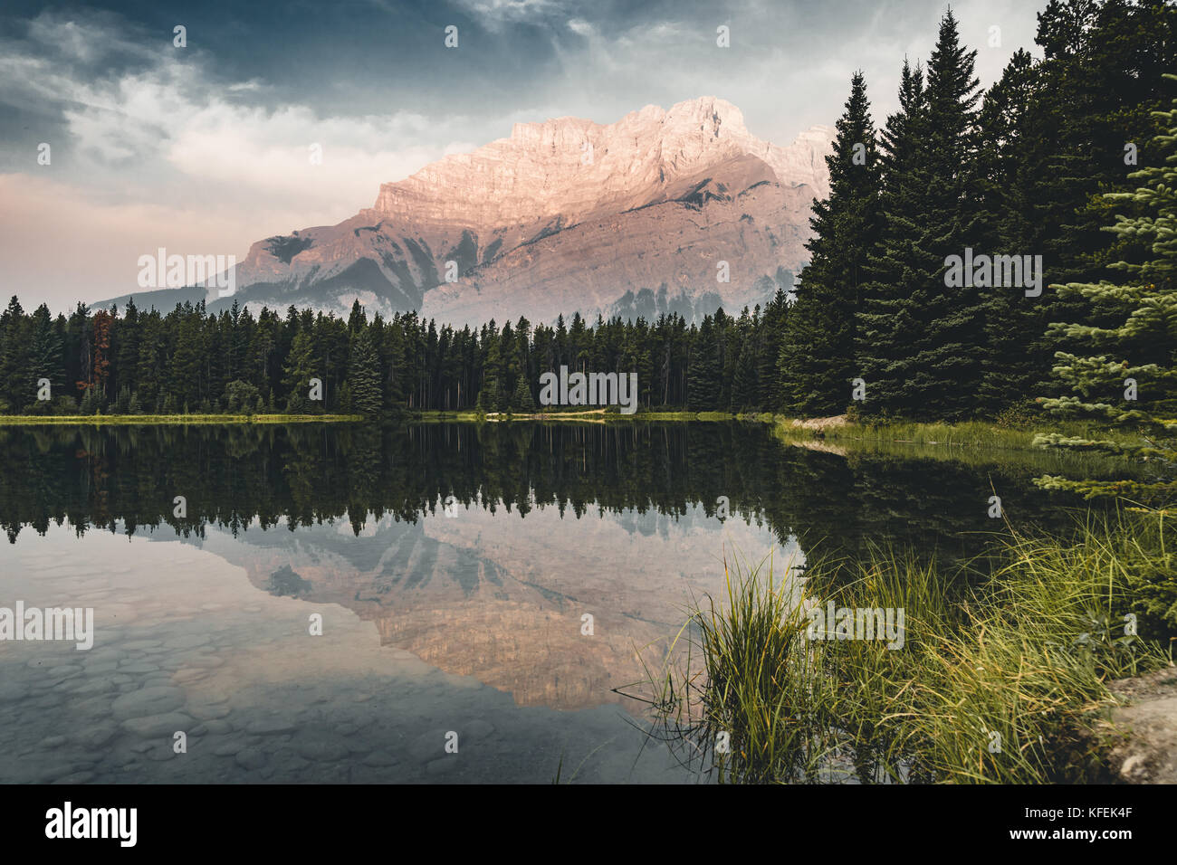 Two Jack Lake with mountain reflections along the Two Jack Lake - Stock Image