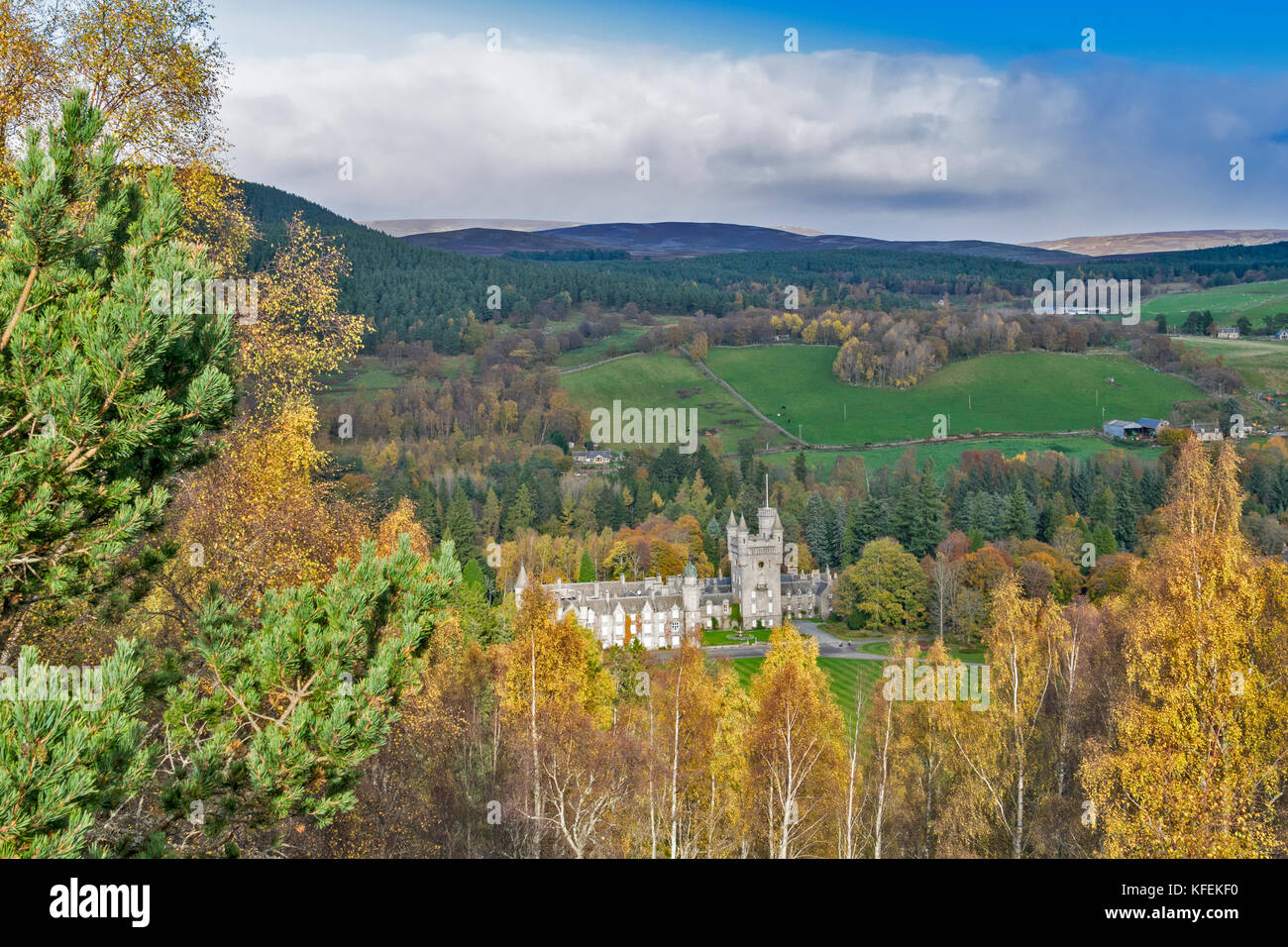 BALMORAL CASTLE ROYAL DEESIDE ABERDEENSHIRE SCOTLAND SUNLIGHT ON THE CASTLE  BIRCH TREES WITH AUTUMN LEAVES FARMS - Stock Image