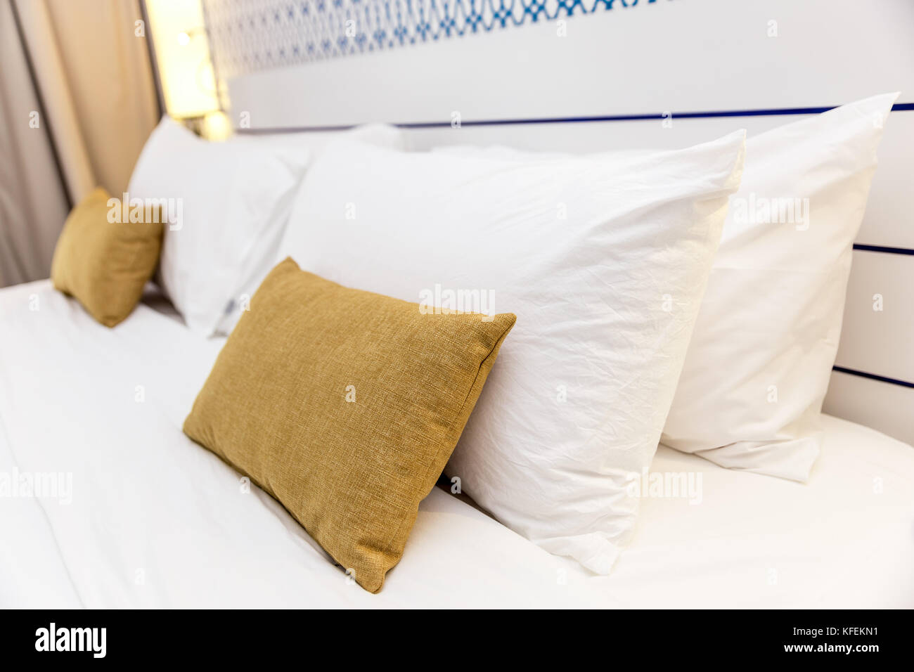 Comfy yellow pillows, hotel bedroom, saidia, Morocco - Stock Image