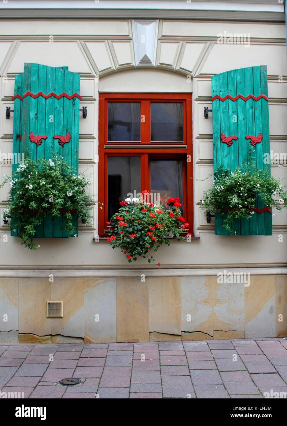 A decorative window in the Old Town Krakow. - Stock Image