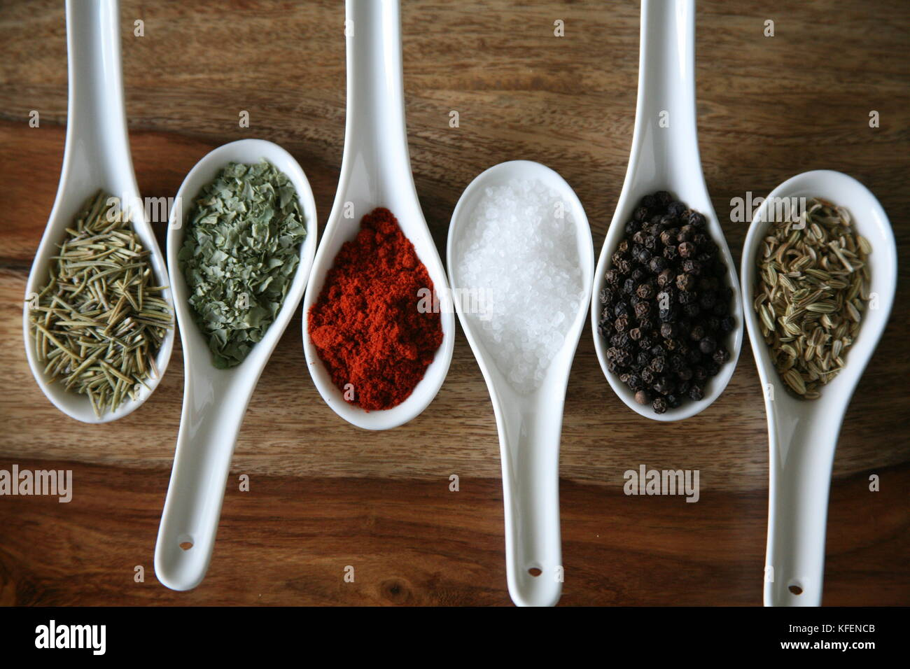 Chinese soup spoons filled with colourful spices - Stock Image