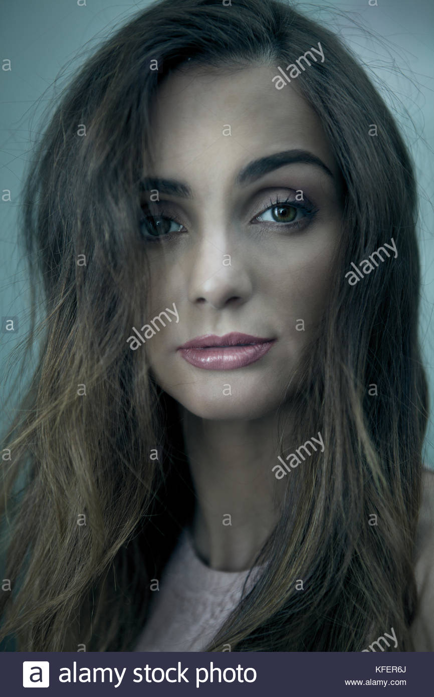 Sad traumatized young woman, face portrait - Stock Image