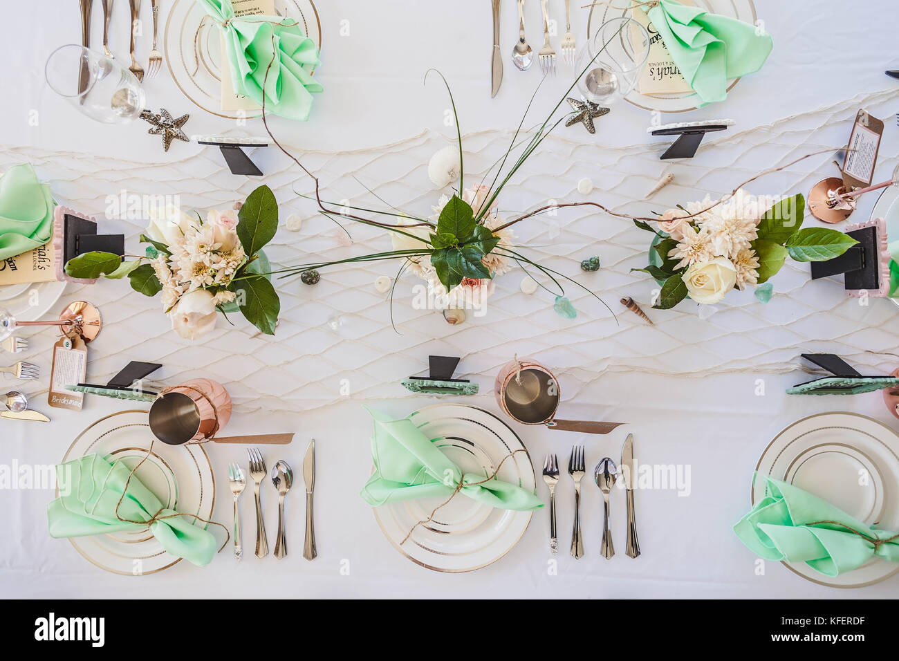 Elegant beach themed wedding table setting with mint green napkins ...