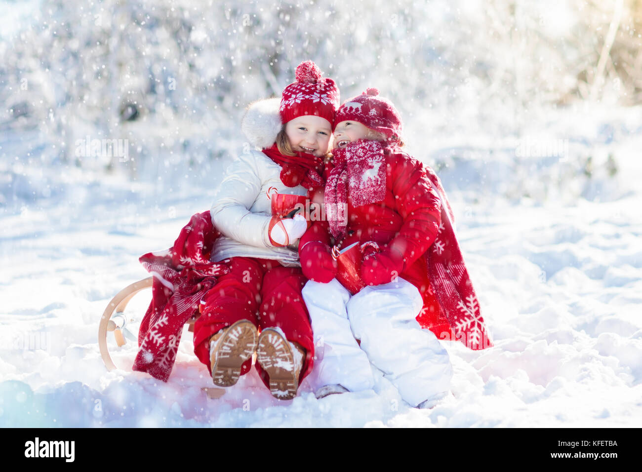 Christmas Vacation Sled.Kids Sledding In Winter Forest Children Drink Hot Chocolate