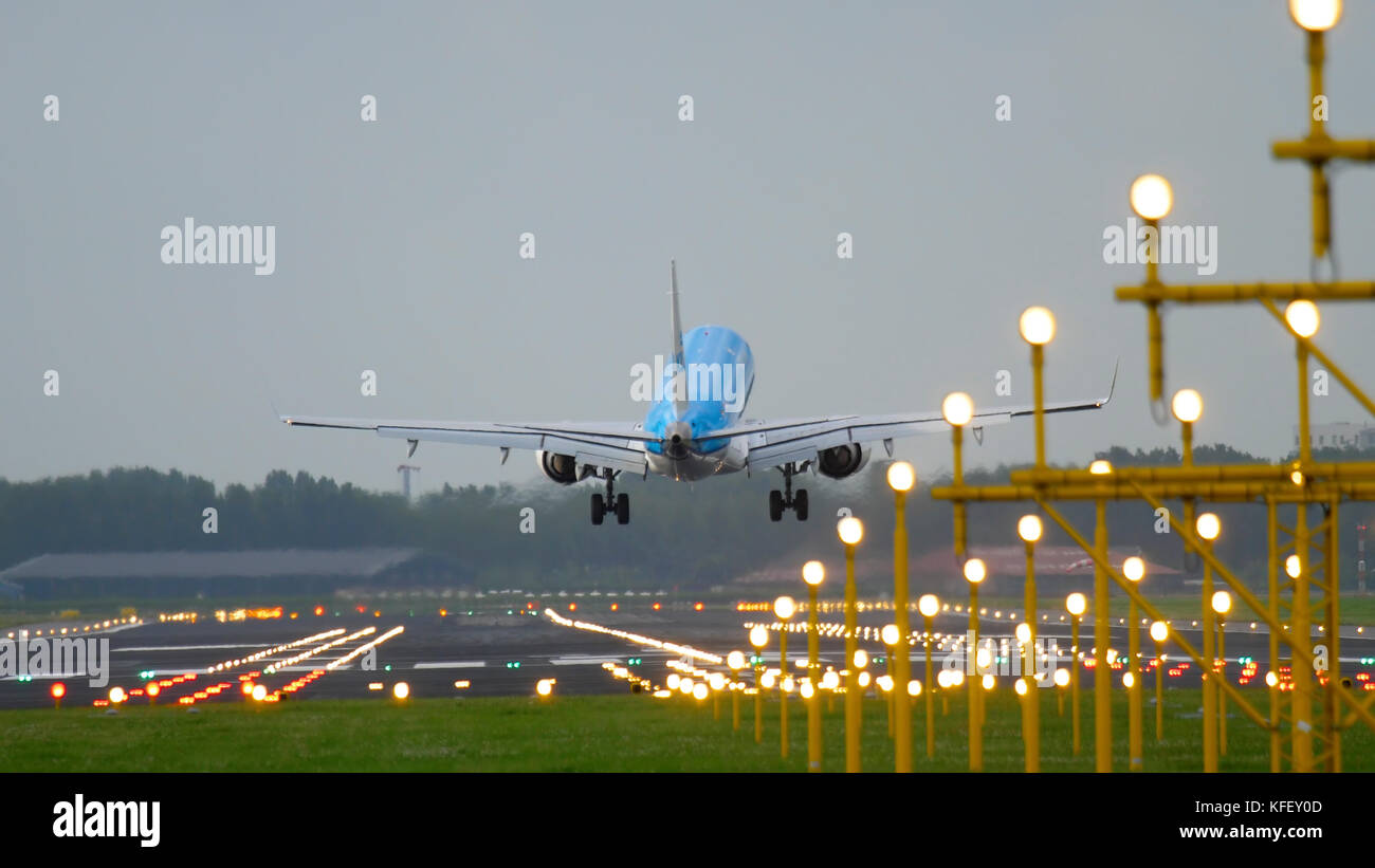 AMSTERDAM, THE NETHERLANDS - JULY 27, 2017:  KLM Cityhopper Embraer 175 landing on runway 18R Polderbaan. Shiphol - Stock Image