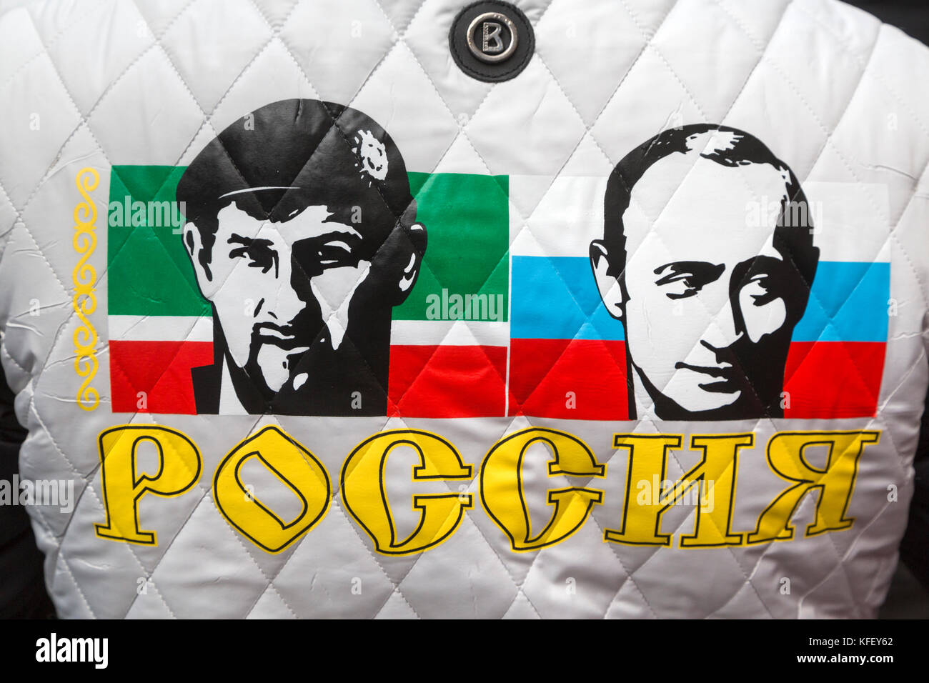 Portraits of Ramzan Kadyrov and Vladimir Putin on the back of the activist of the movement 'Antimaydan' - Stock Image