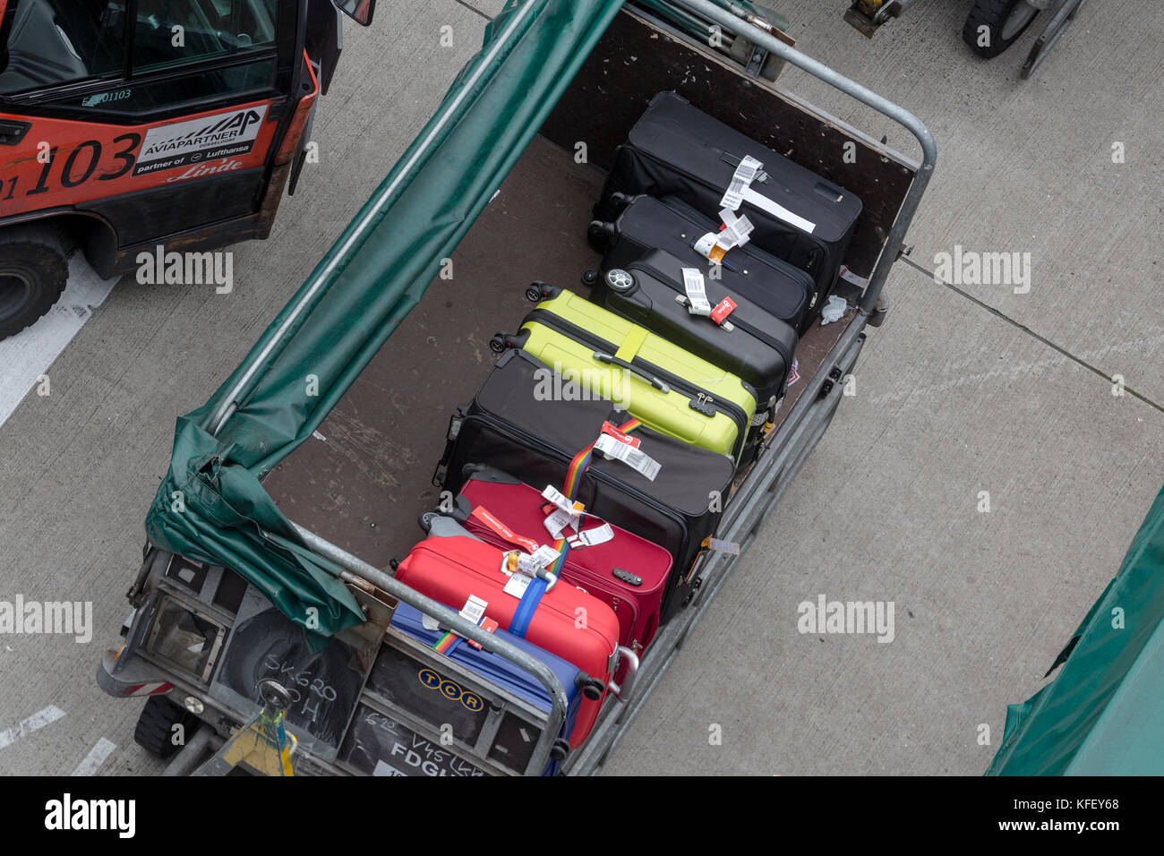 Top view of loading luggage of passengers before the flight departure from an airport - Stock Image