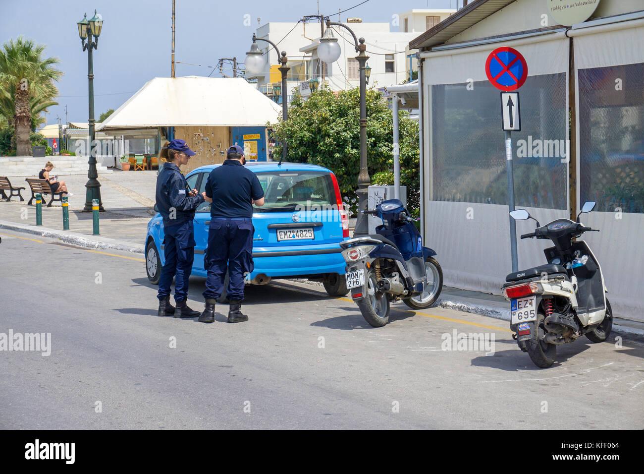 Greek traffic police at a car parking at no waiting, Naxos-town, Naxos island, Cyclades, Aegean, Greece Stock Photo