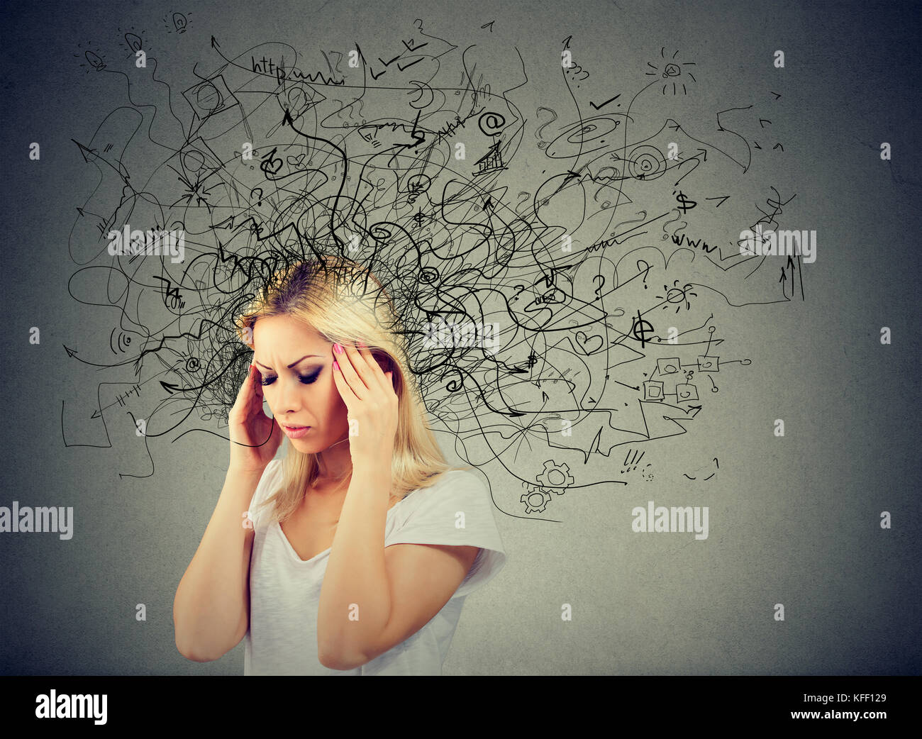 Thoughtful blonde woman with a mess in her head - Stock Image