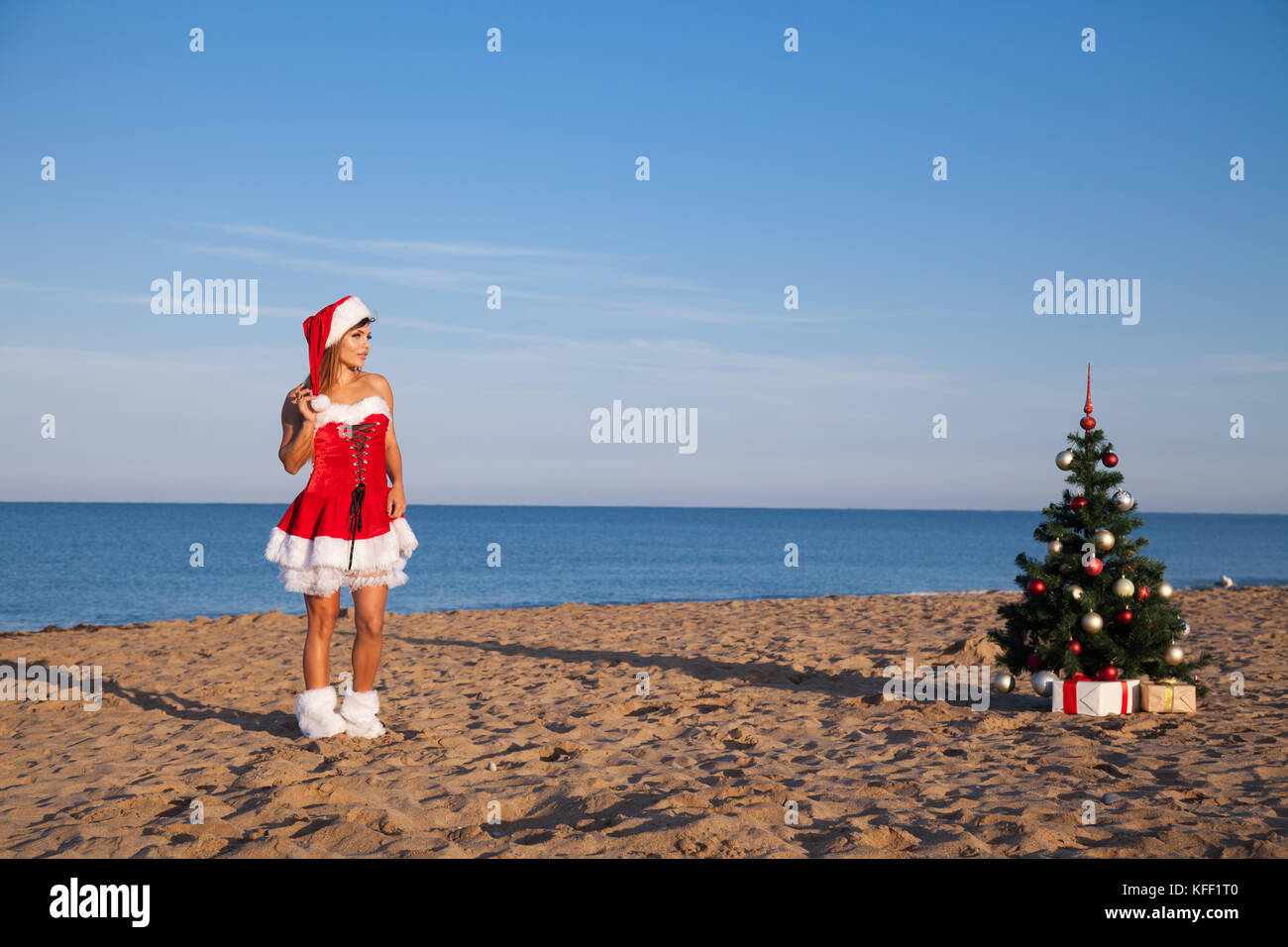 3608153a81 girl on the beach on Christmas and new year at the resort - Stock Image