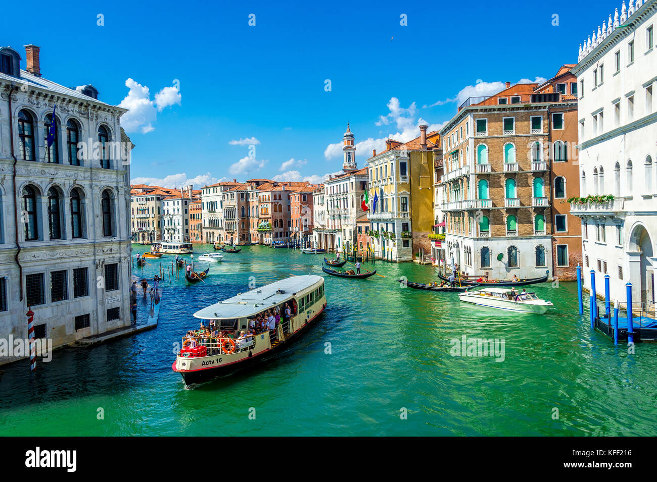 A Vaporetto and Gondolas on the Grand Canal in Venice, Italy - Stock Image