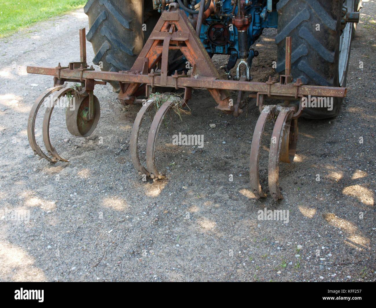 Tractor powered homemade potato three furrow plow Stock