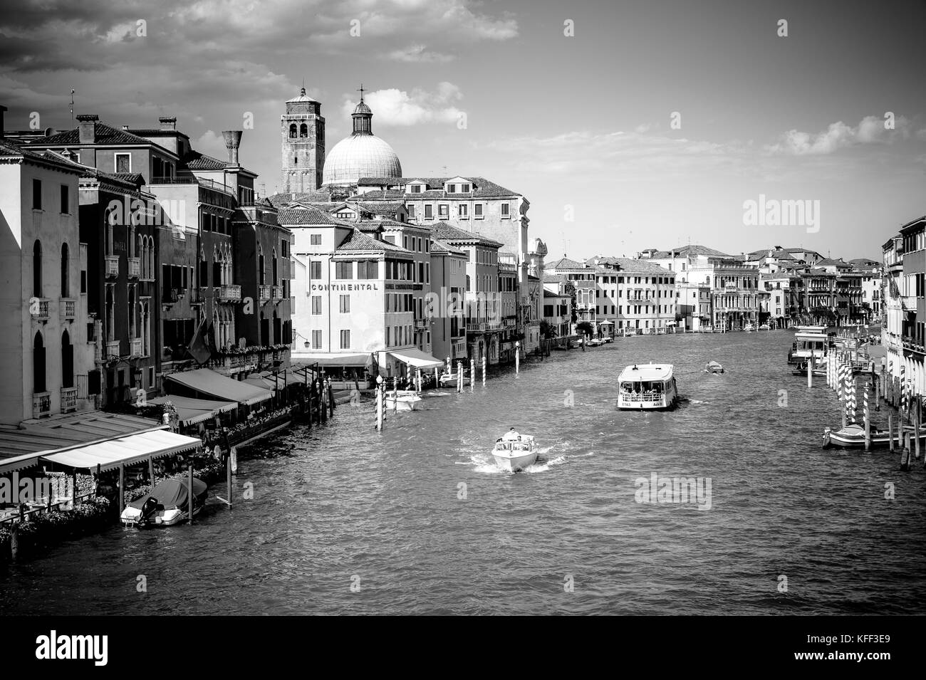 A vaporetto and private boat on the Grand Canal in Venice, Italy - Stock Image
