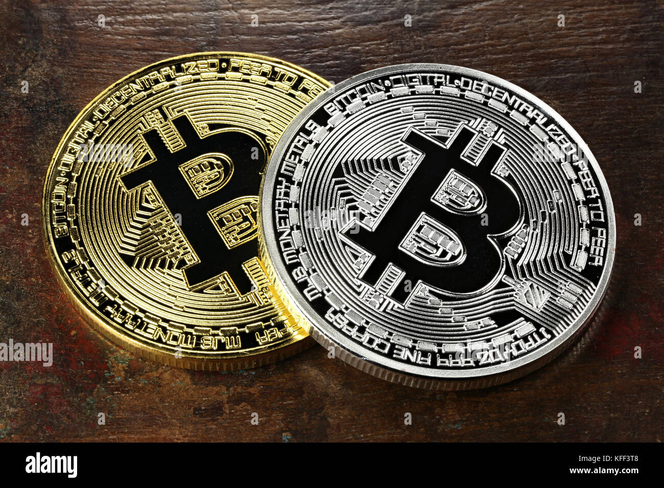 golden and silver bitcoins on wooden background Stock Photo