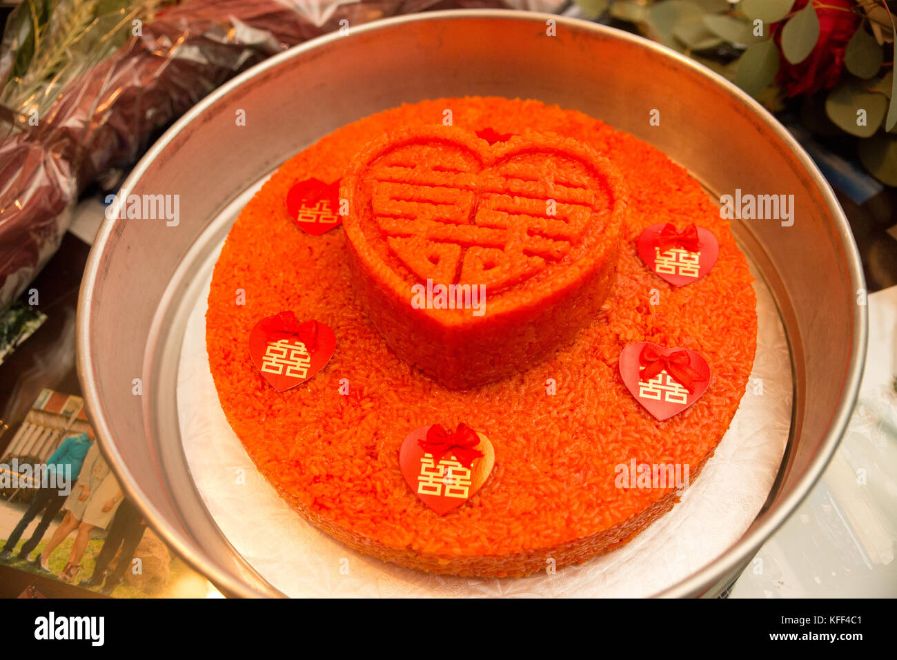 traditional red rice cake in a tin box gift from grooms family to brides family in Vietnamese culture - Stock Image