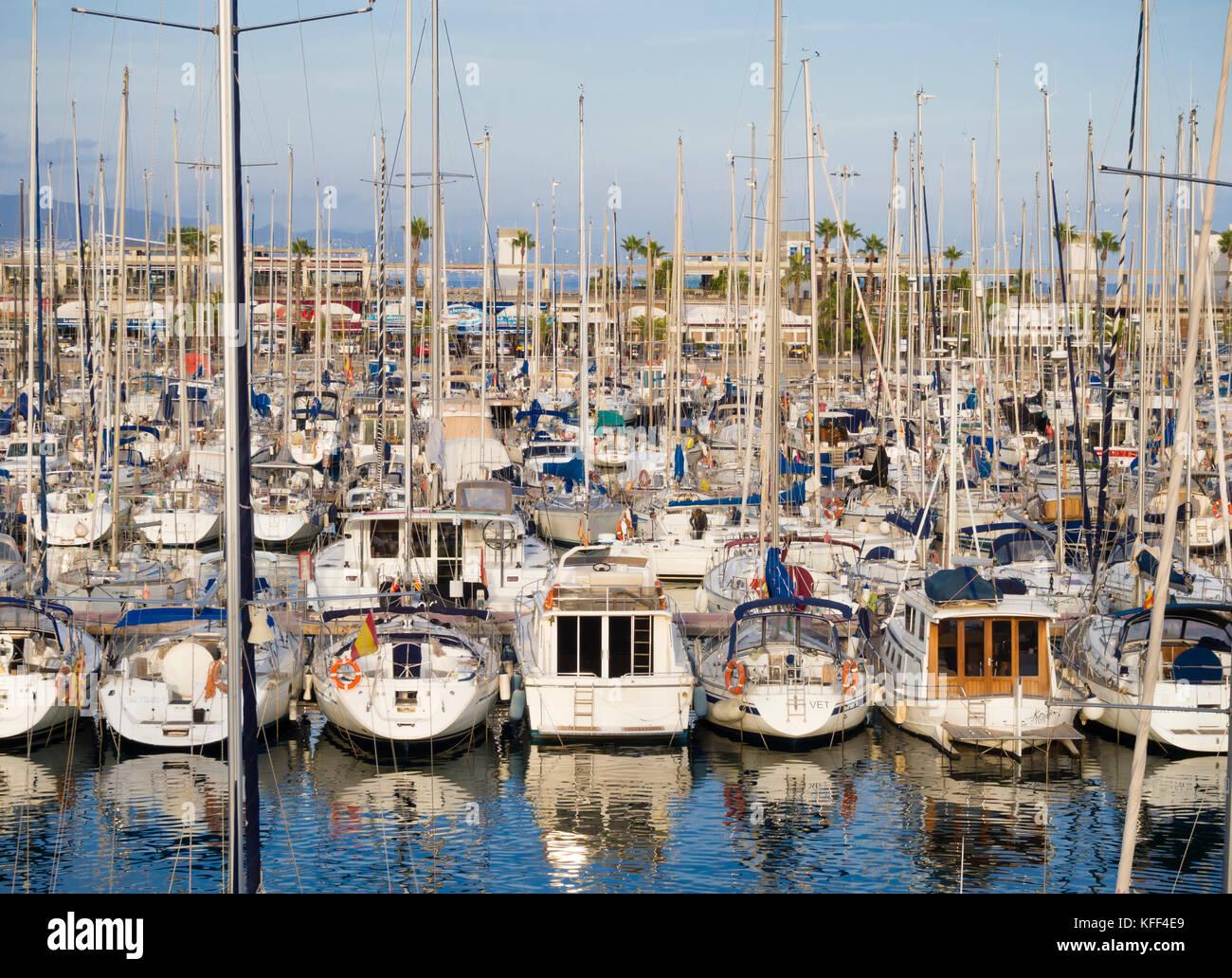 Barcelona, Spain - 11 Nov 2016: many yachts are parked at Barcelona's marina. - Stock Image