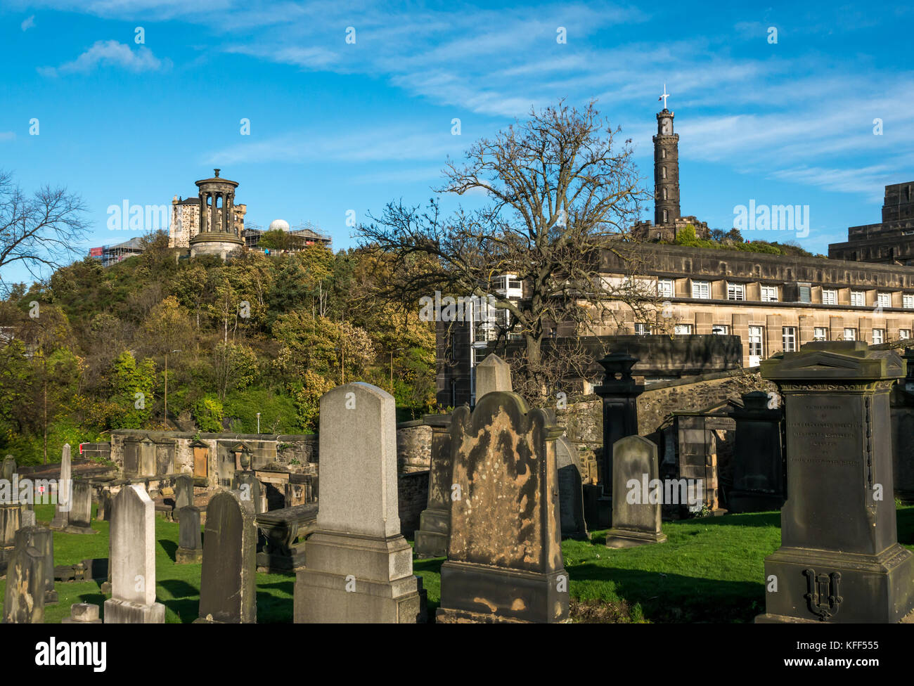 Old gravestones in Old Calton burying ground cemetery Edinburgh, Scotland and view to Calton Hill, with Nelson column Stock Photo
