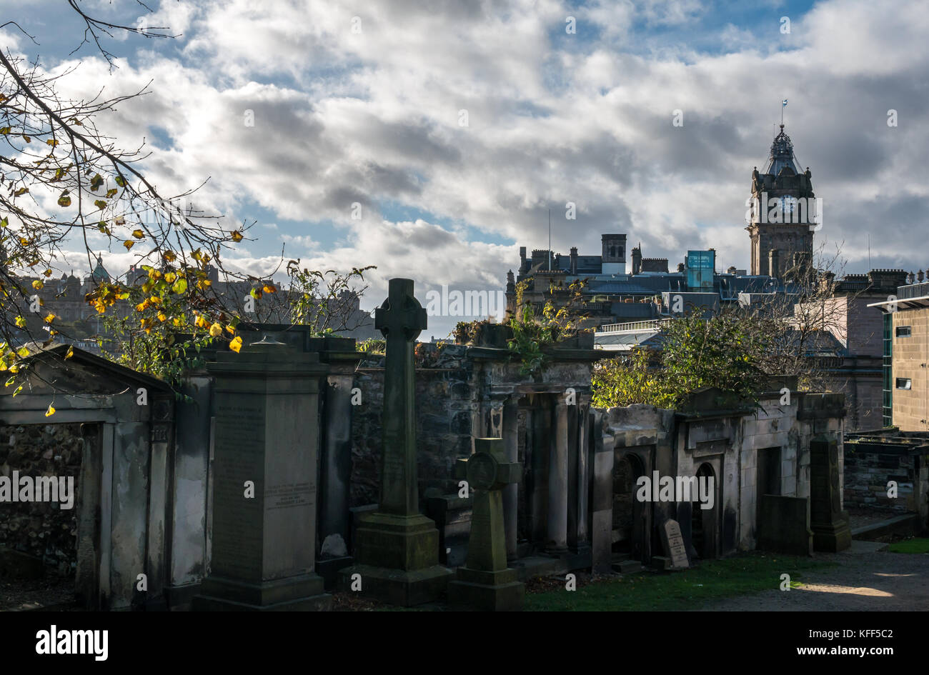 Gravestones and mausoleums in Old Calton burial ground cemetery, Edinburgh, Scotland, UK, and view of city centre Stock Photo