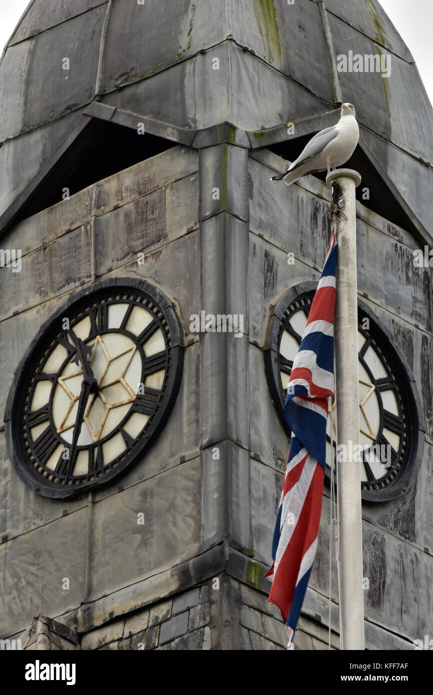 The typically cornish clock tower in the centre of wadebridge in nort cornwall with a Union Jack or flagpole with - Stock Image