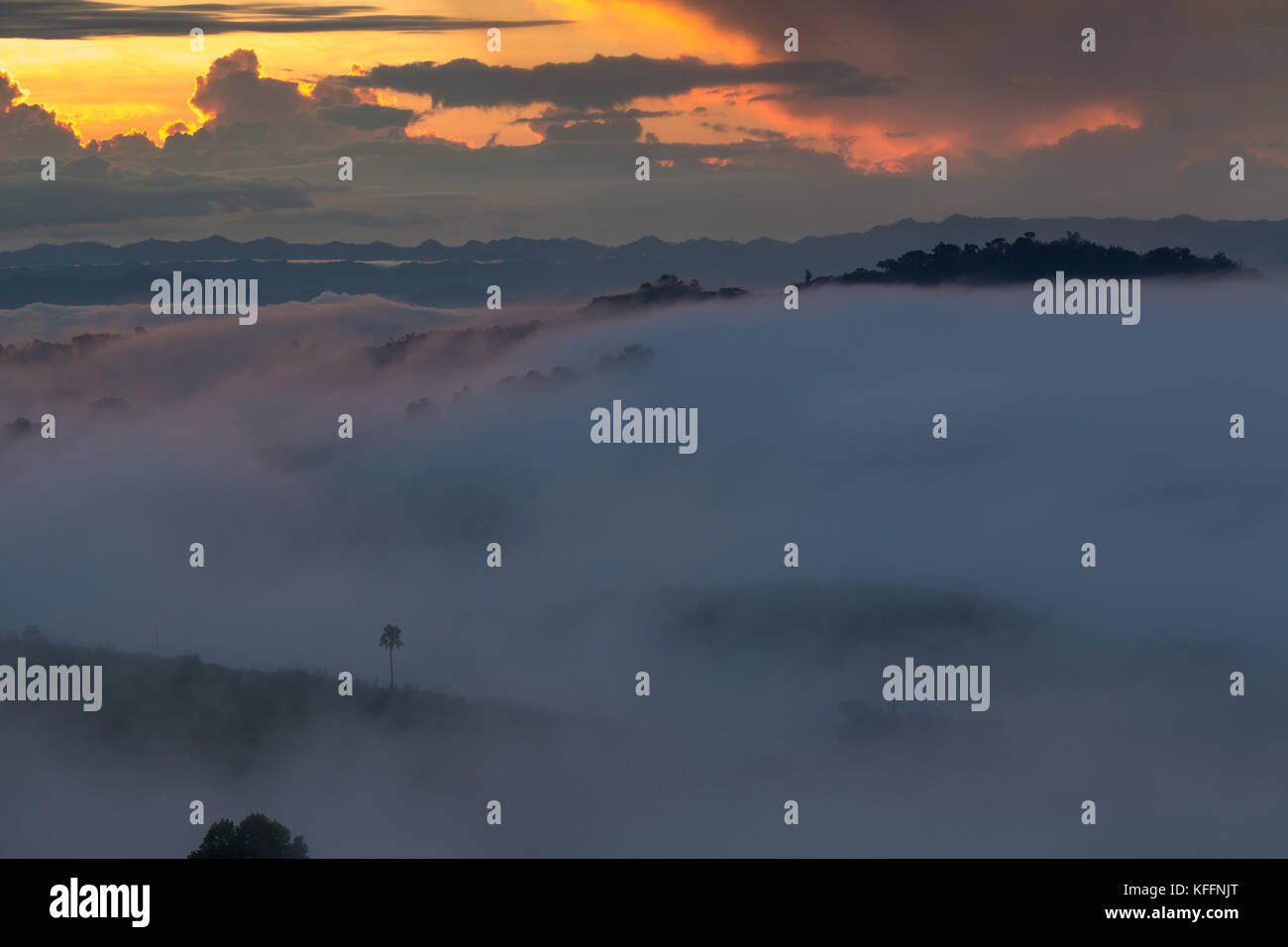 Sun rises and foggy./Mountain and Foggy in Phetchabun Province, Thailand. - Stock Image
