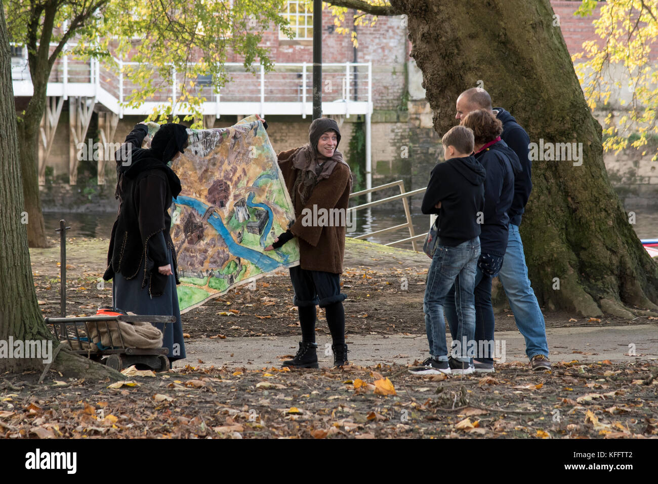 Street entertainers and audience in Tower Gardens, York - Stock Image