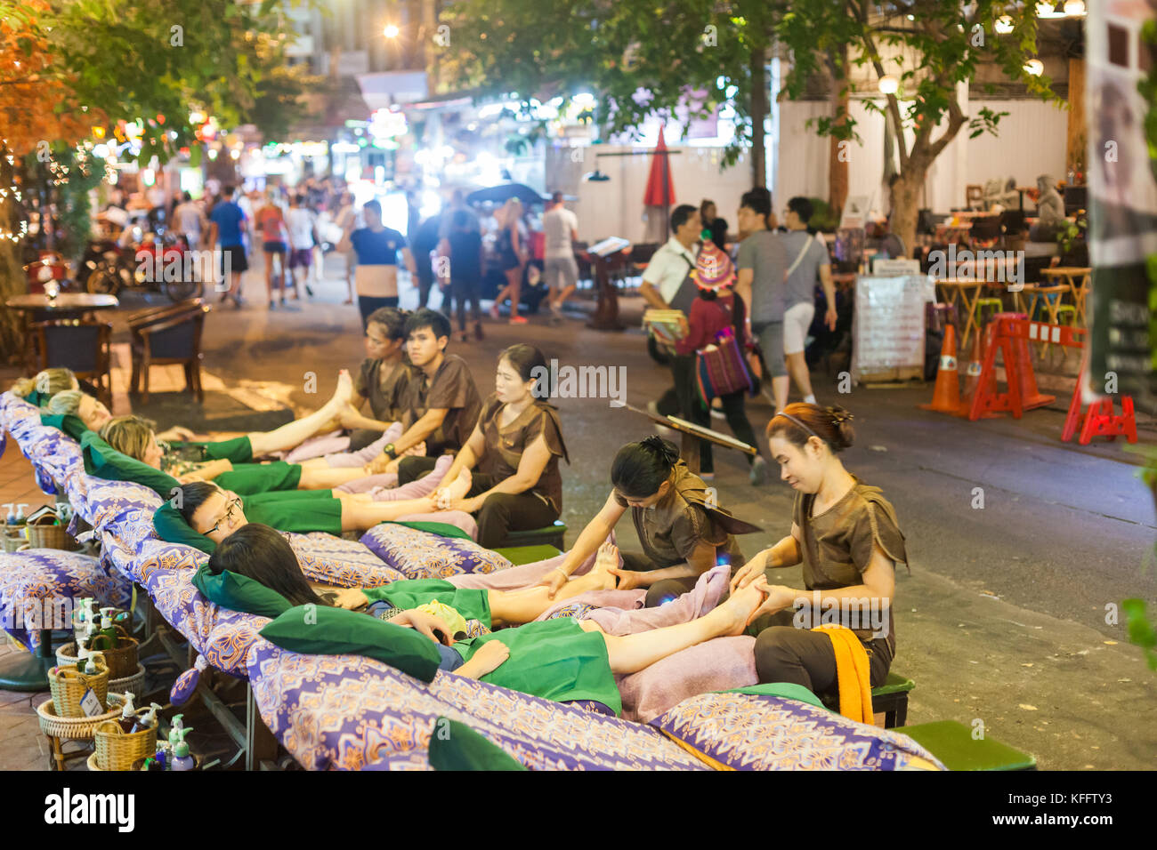 Tourists getting massages just off Khao San Road, Bangkok Stock Photo