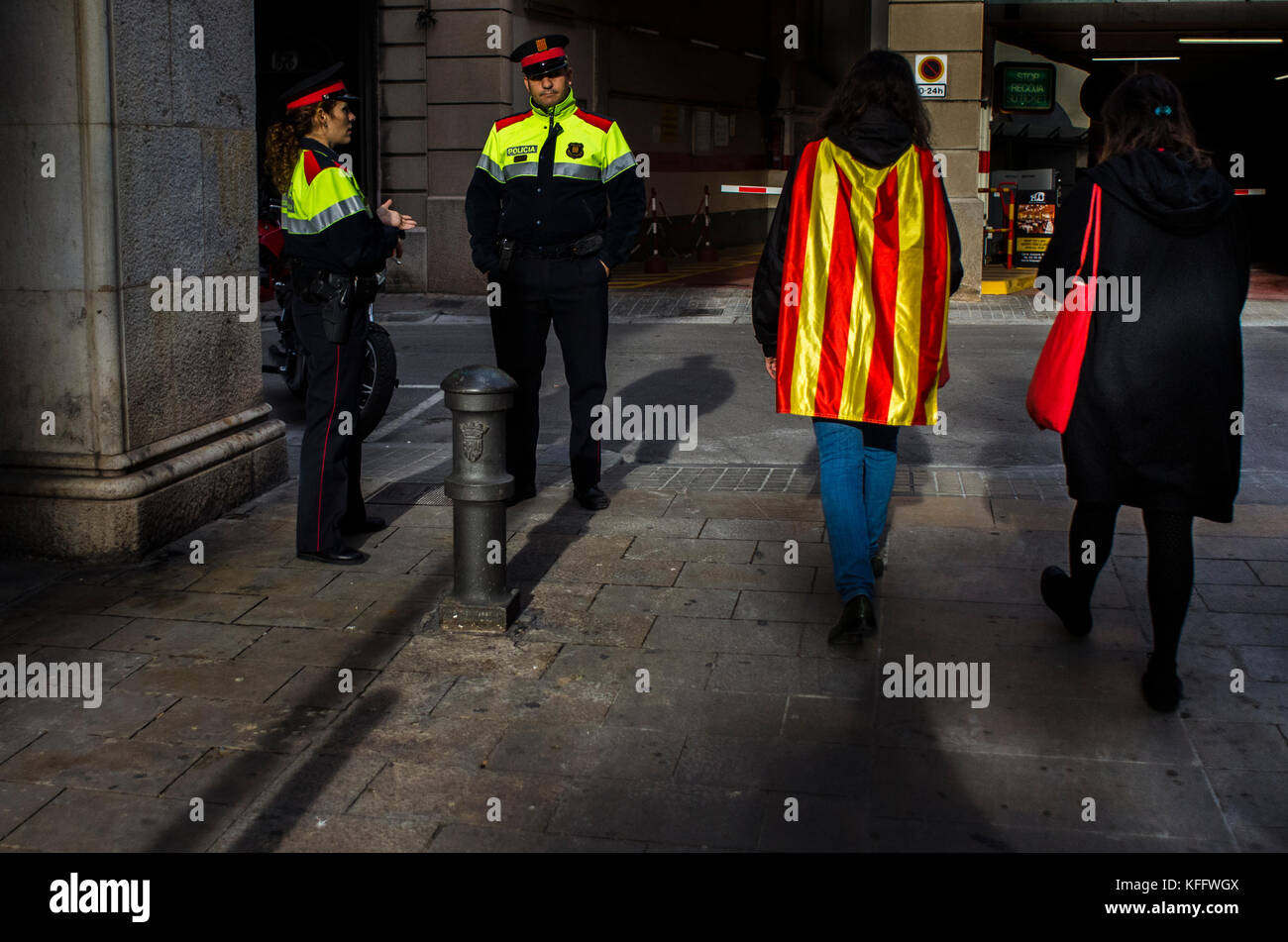 Two women walking in front of the police after voting on the 'parcicipation day' of November 9, 2014 in - Stock Image