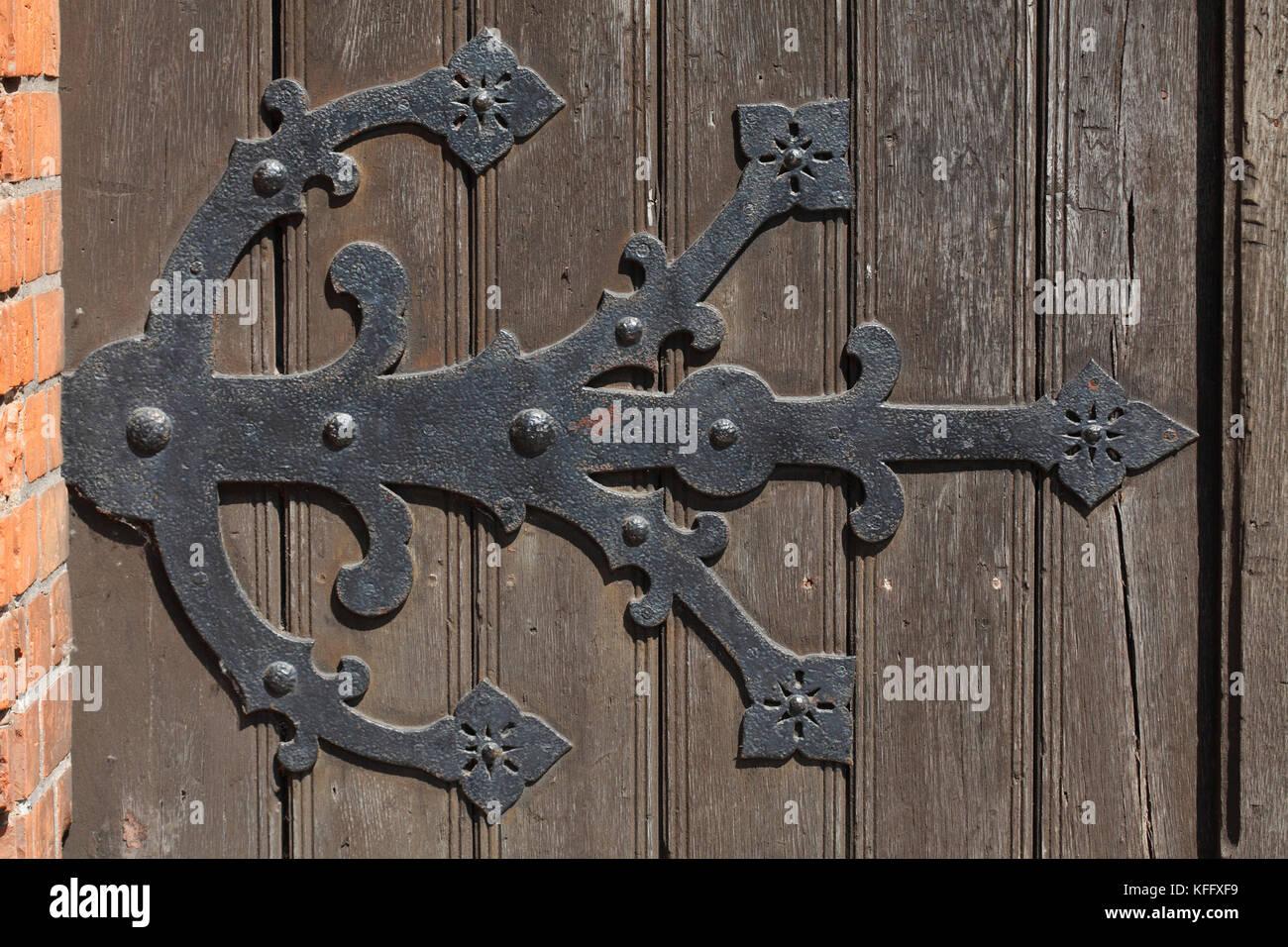 old iron door fitting on an old church door, Marienkirche church , Old Town, Stralsund, Mecklenburg-Western Pomerania, - Stock Image