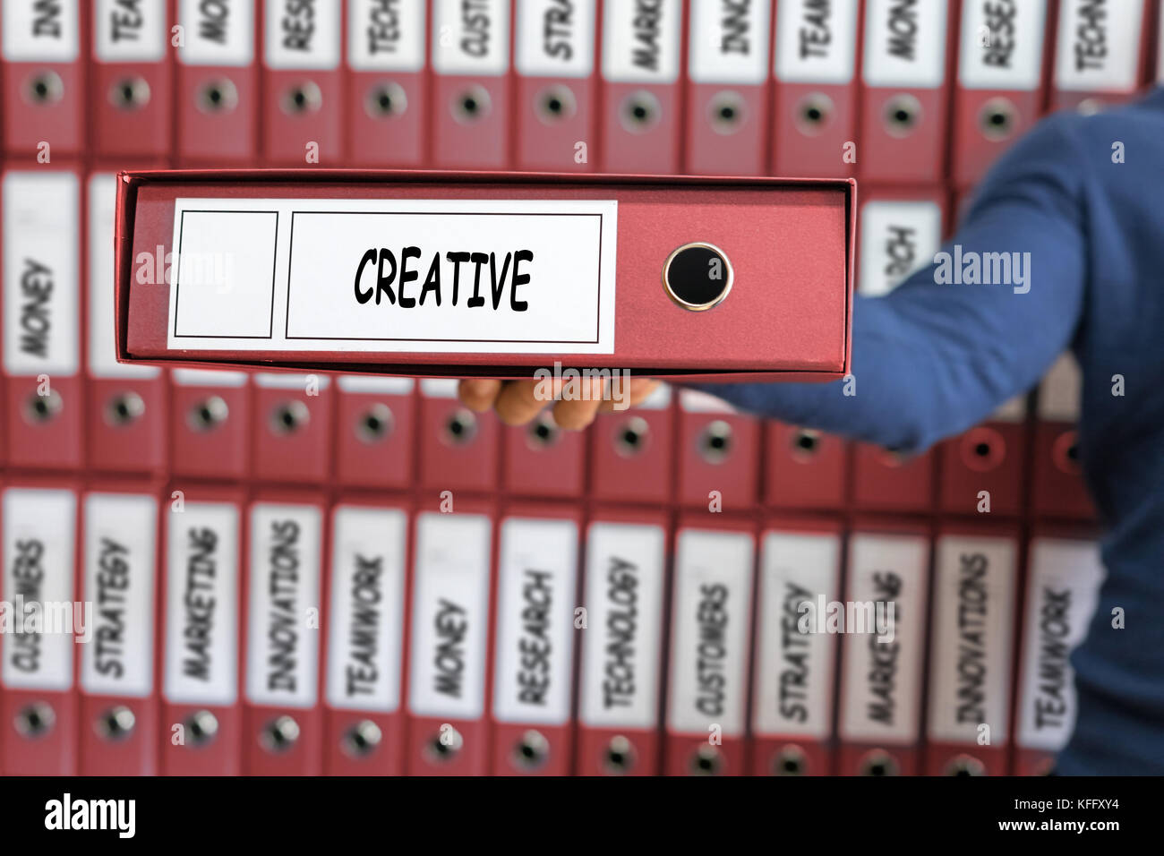 Creative Creativity Ideas Innovation Development Inspire Concept. Young man holding ring binder. - Stock Image