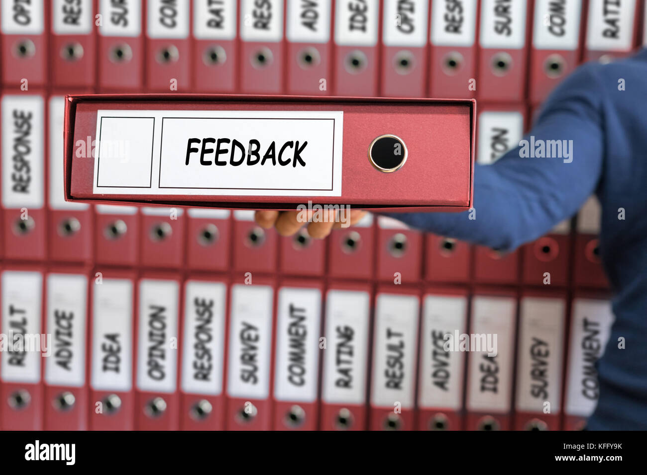 Feedback concept. Feedback Business Quality Opinion Service Communication concept. Young man holding ring binder. - Stock Image
