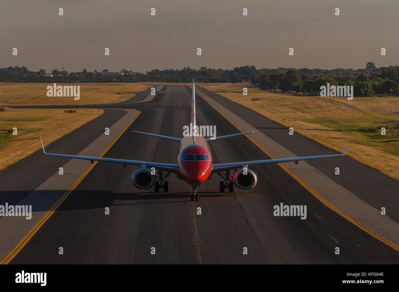 An Embraer 190 airliner, from Virgin Blue, arriving at Perth airport, Western Australia. - Stock Image