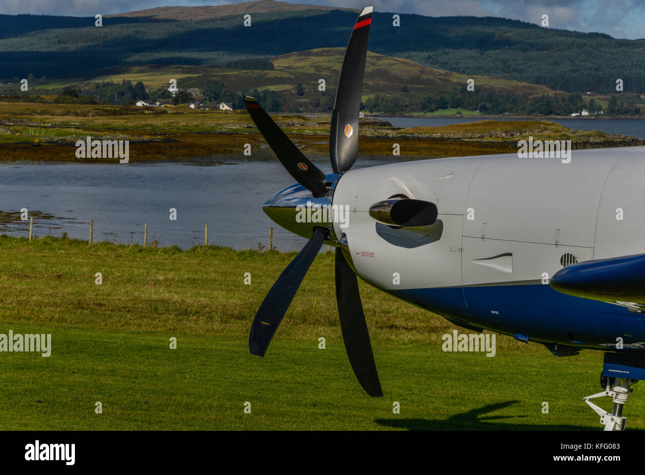 Close up static nose detail of a Pilatus PC12 aircraft, with feathered prop. - Stock Image