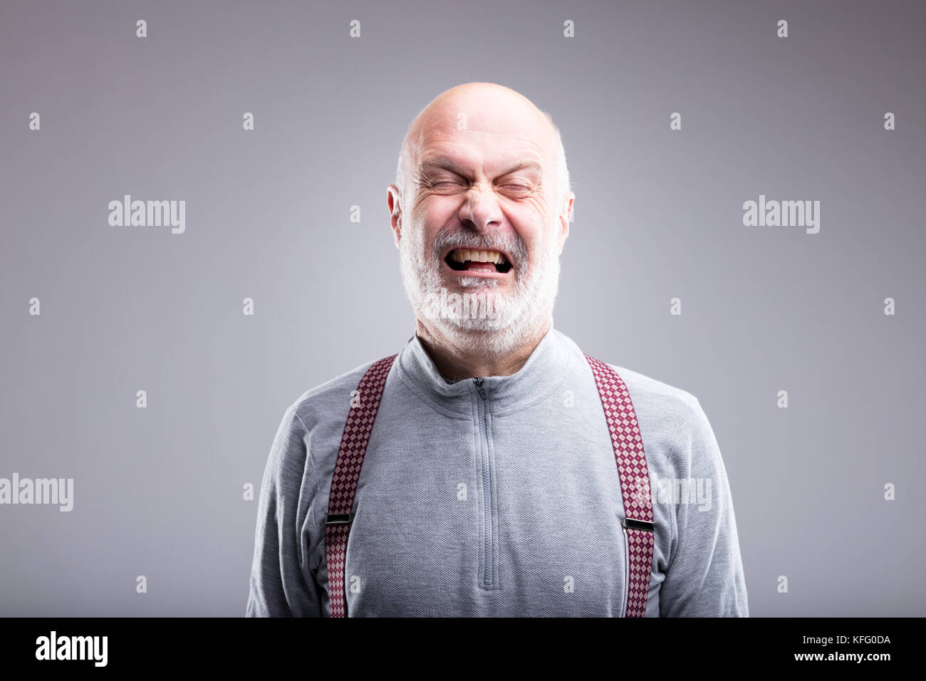 teatrical exaggerated expression of an old man crying - Stock Image