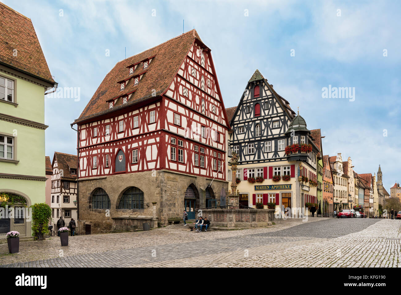 ROTHENBURG, GERMANY - OCTOBER 24, 2017: Unidentified tourists stroll along the historic main road or take a break - Stock Image
