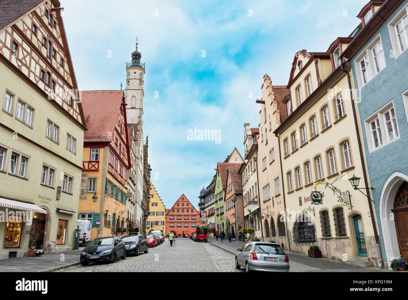 ROTHENBURG, GERMANY - OCTOBER 24, 2017: Unidentified pedestriants walk along the historic main road with its historic - Stock Image