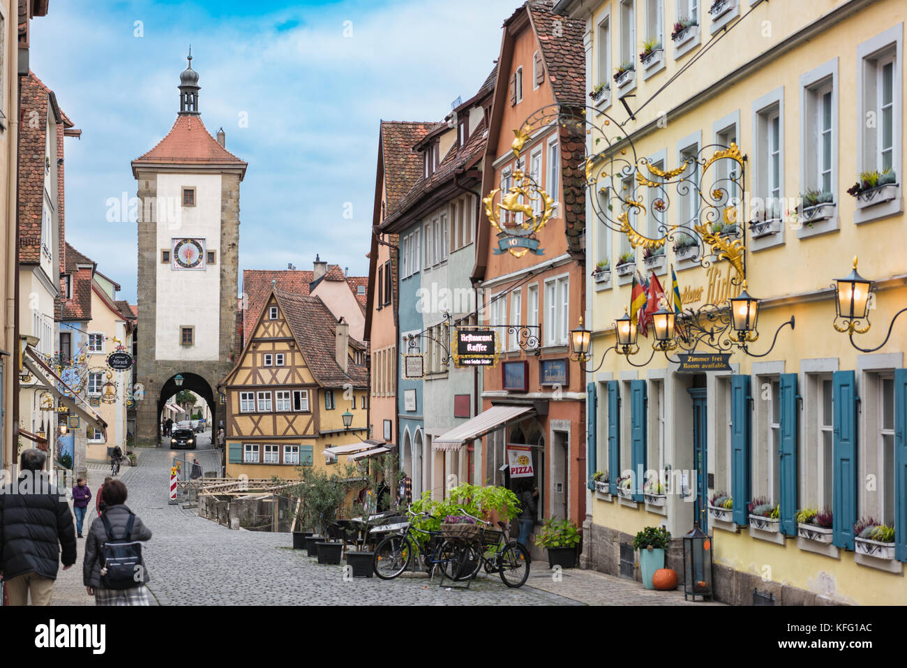 ROTHENBURG, GERMANY - OCTOBER 24, 2017: Unidentifies tourists stroll along on of the famous alleyways that leads - Stock Image