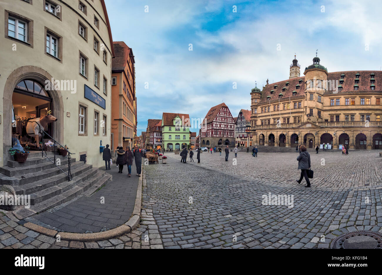 ROTHENBURG, GERMANY - OCTOBER 24, 2017: Unidentified tourists enjoy a sightseeing tour across the historic marketplace - Stock Image