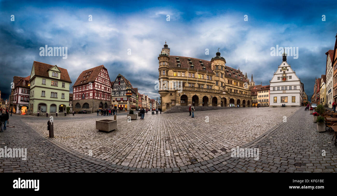 ROTHENBURG, GERMANY - OCTOBER 24, 2017: Few unidentified tourists and pedestriants enjoy the blue hour atmosphere - Stock Image