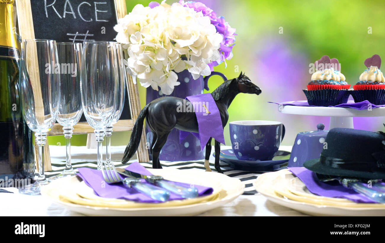 Horse racing Racing Day Luncheon fine dining table setting with small black fascinator hat decorations and ch&agne. & Horse racing Racing Day Luncheon fine dining table setting with ...