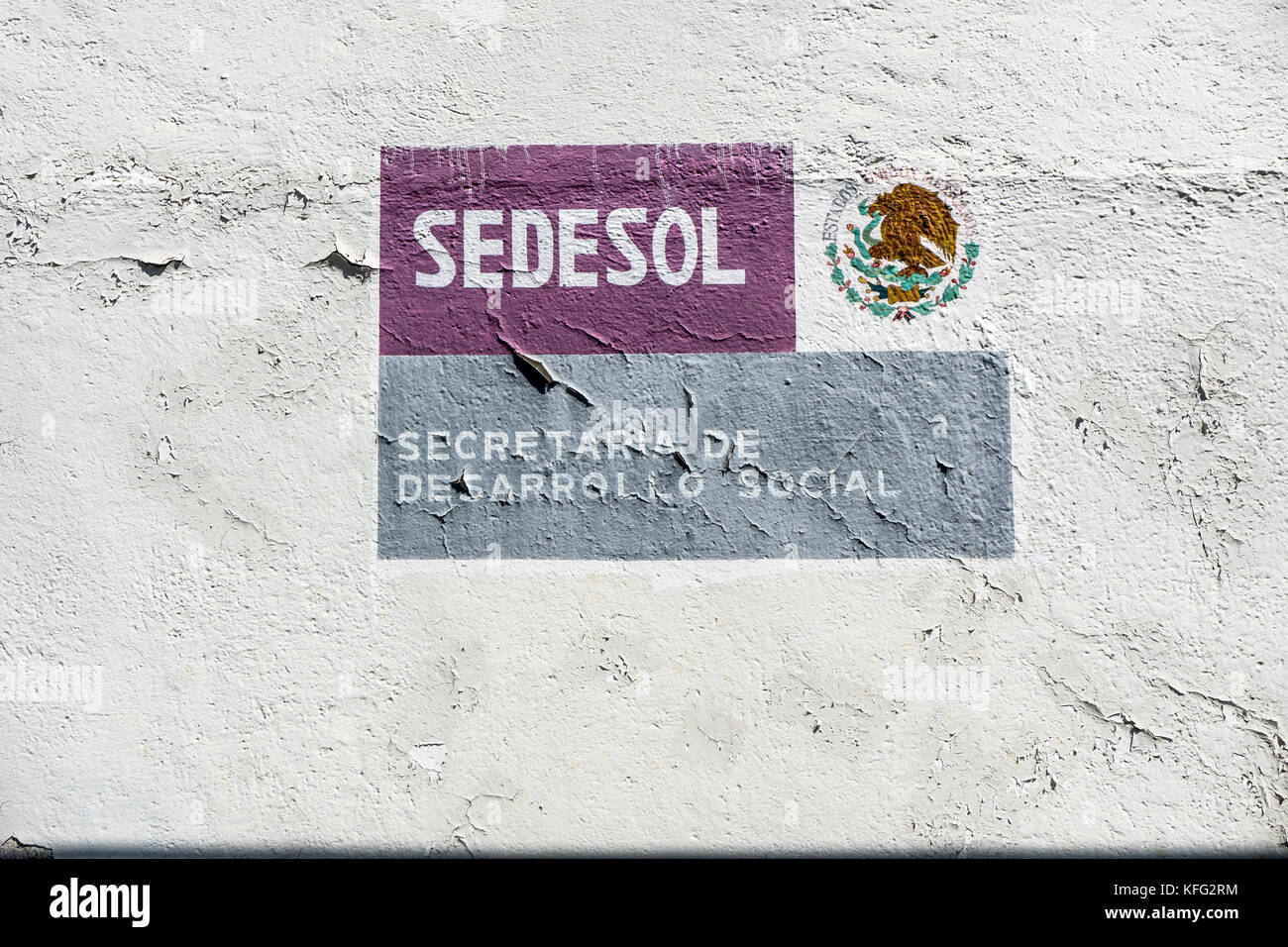 fading logo Mexican Government department concerned with enhancing well being of underclass in urban & rural - Stock Image