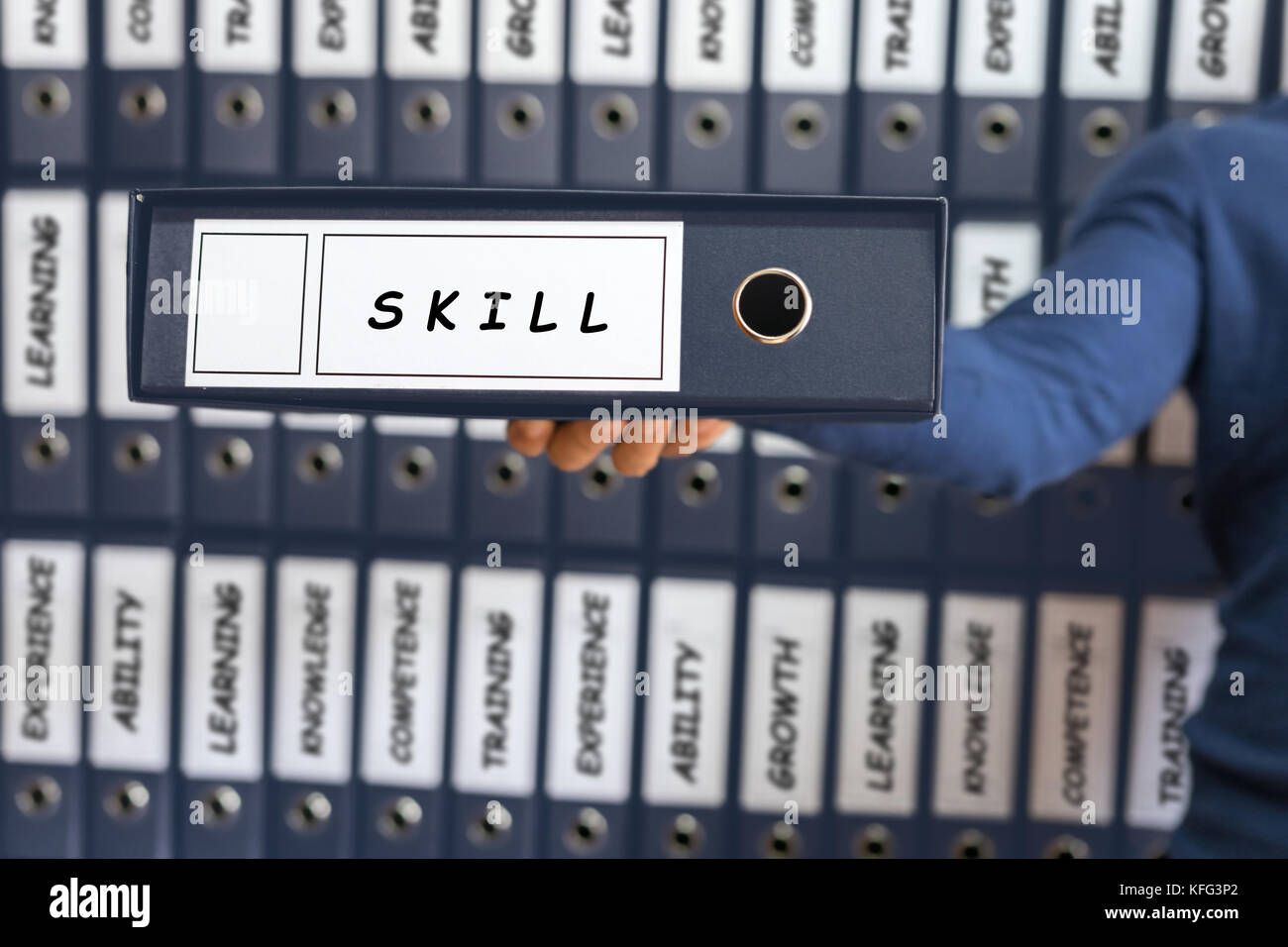 Skill Business Concept. Skill concept. Young man holding ring binder. - Stock Image