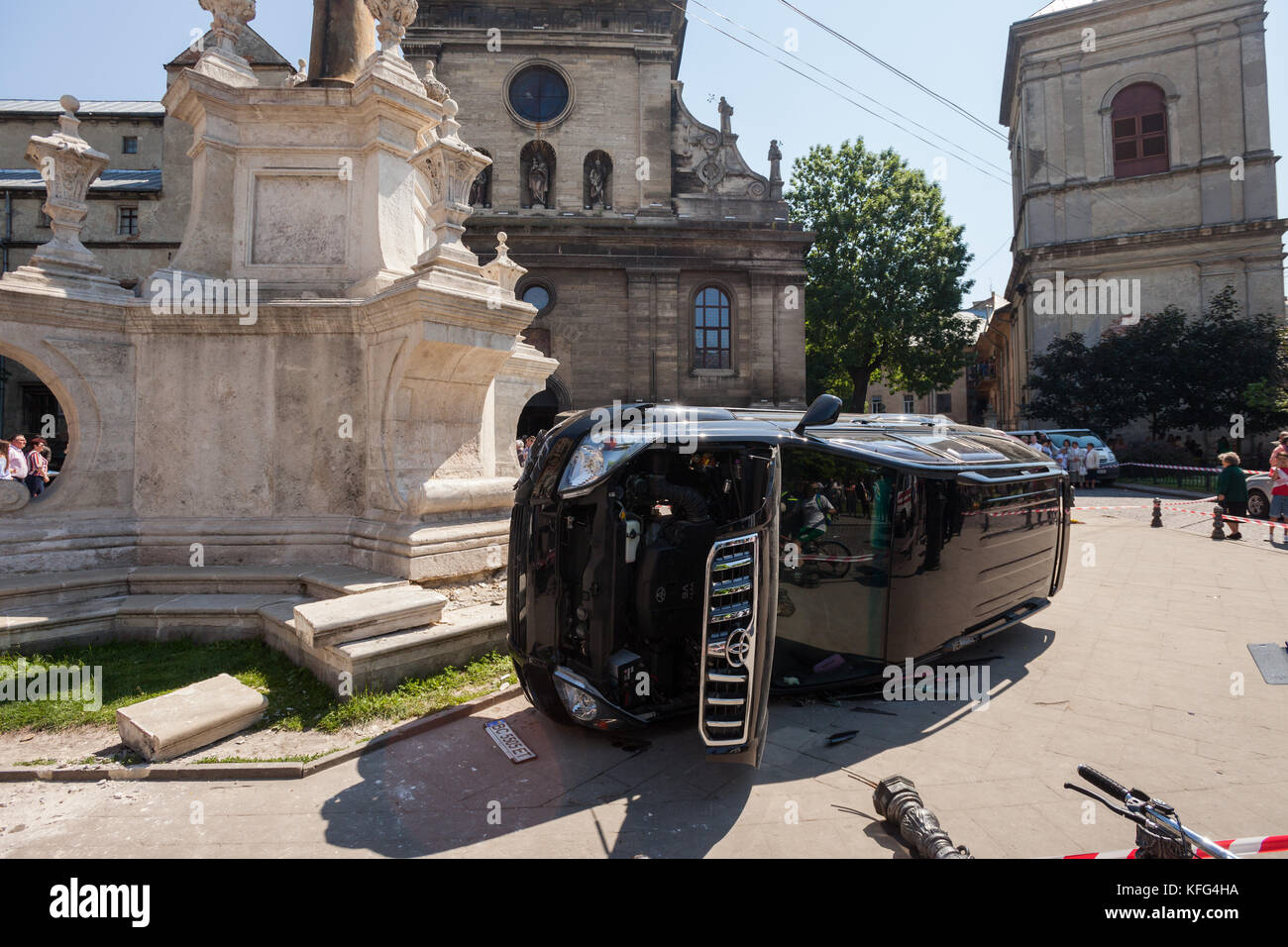 LVIV, UKRAINE - JUNE 18: The body of a pedestrian lays next to an overturned SUV on 18 June 2017 in Lviv, Ukraine. - Stock Image