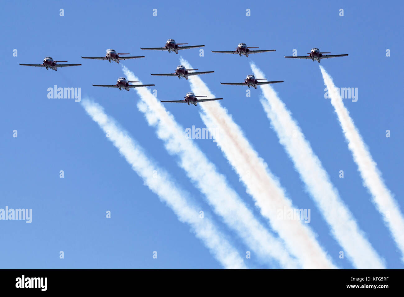 Nine CT-114 Tutor jets of the Canadian Snowbirds pass overhead in a diamond formation. The Snowbirds are part of - Stock Image