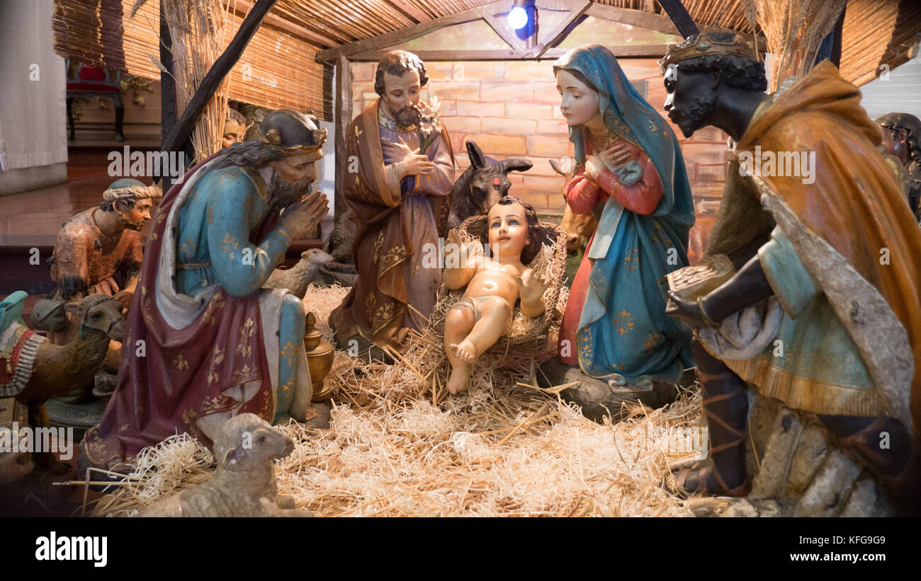 Close up of nativity scene in Buenos Aires church with traditional Mary, Joseph and Christ child surrounded by animals Stock Photo
