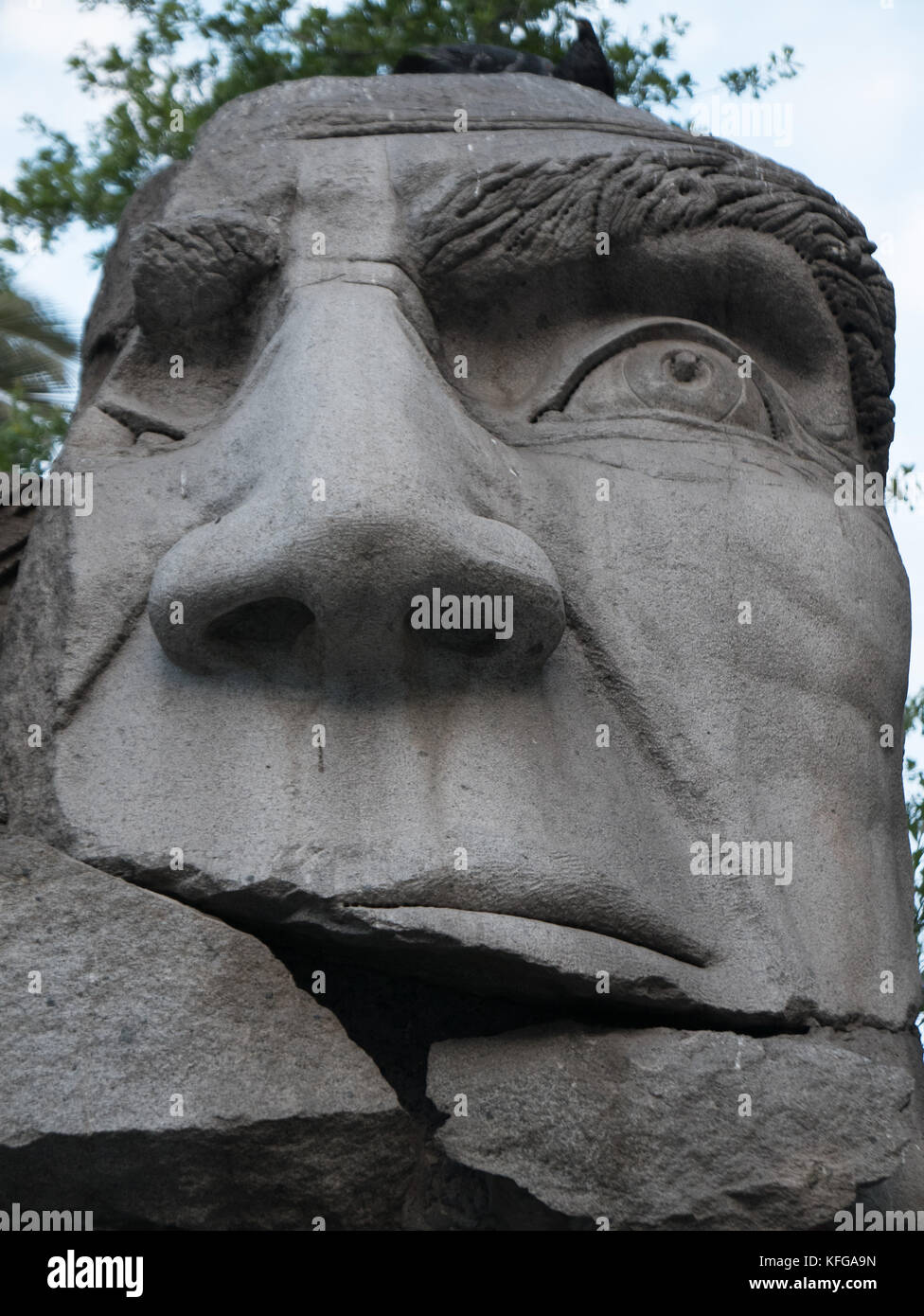 Famous statue located in the Plaza de Armas area of Santiago, Chile. Close-up of head of statue show man's face - Stock Image