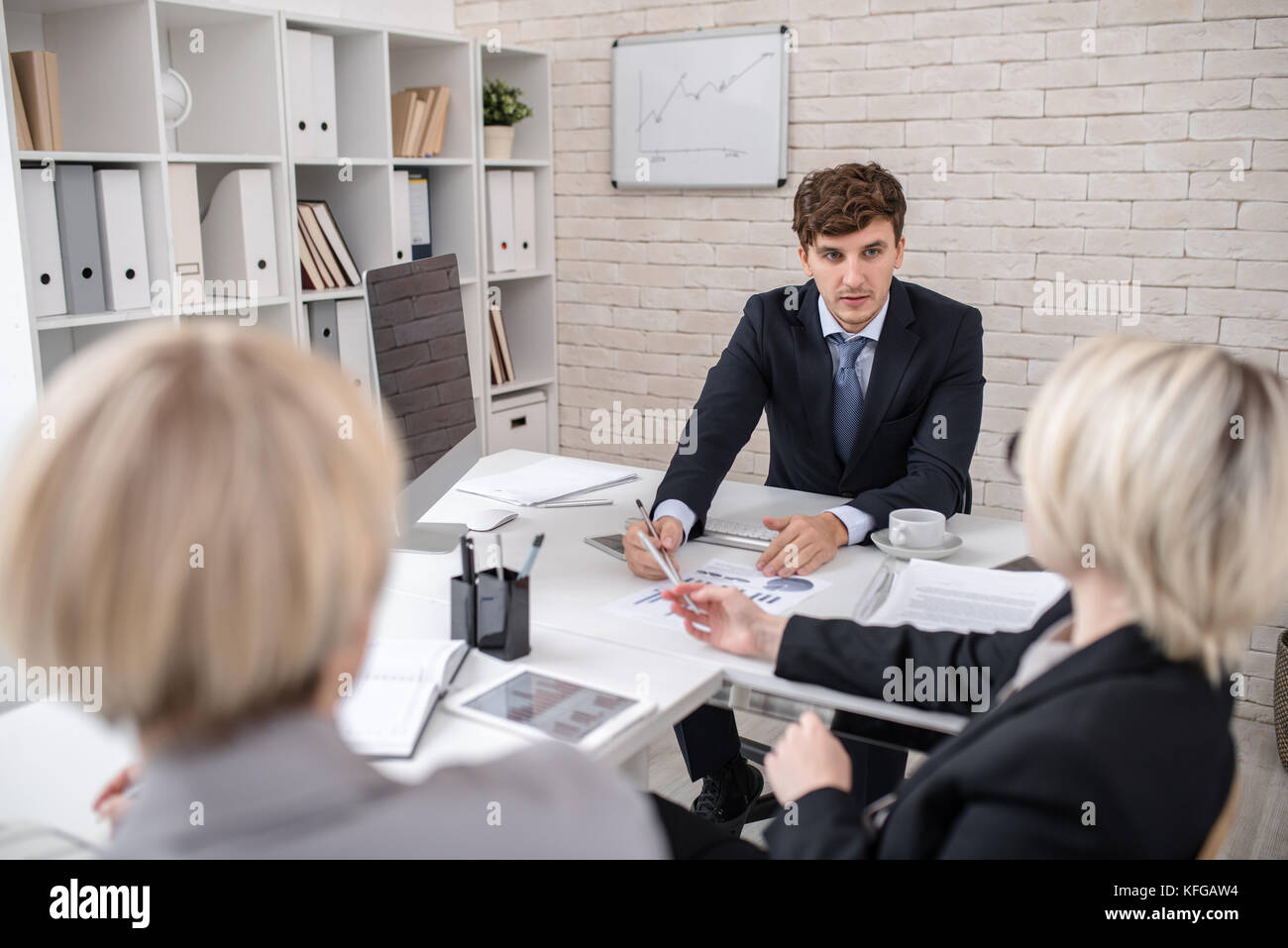 Handsome Man Leading Important Business Meeting in Office - Stock Image