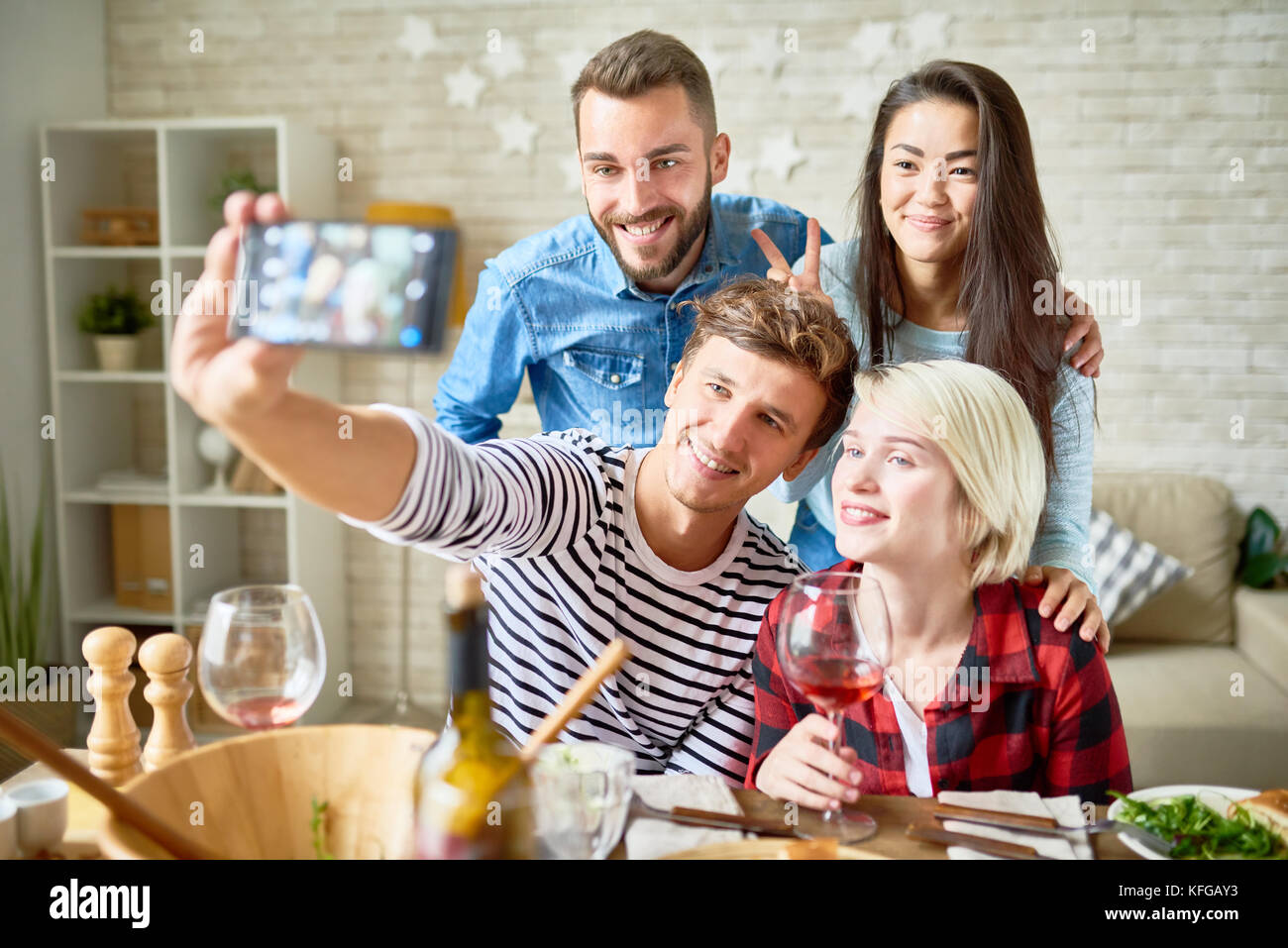 Friend Posing for Selfie at Dinner Party - Stock Image