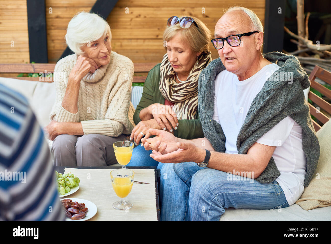 Gathering of Friends at Outdoor Cafe - Stock Image